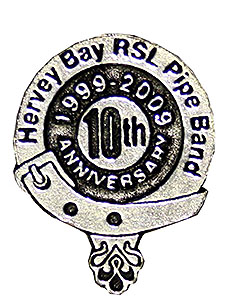 Hervey Bay Pipe Band's commemorative lapel badge